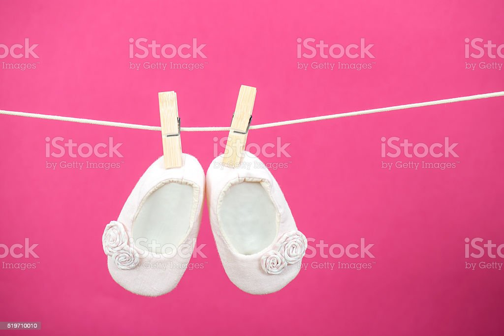Hanging Baby Shoes stock photo