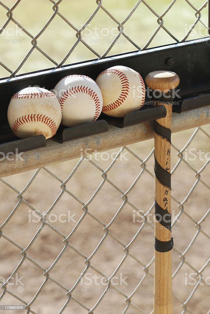 Hanging baseball bat with three balls royalty-free stock photo