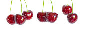 Hanging berries of sweet cherry on a white background