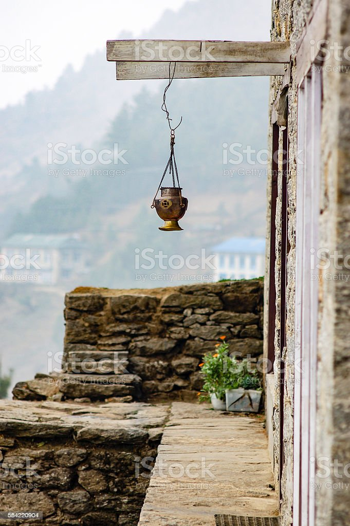 Hanging brass lantern with blurry mountain background stock photo