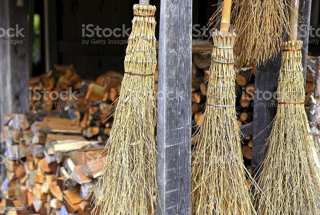 Hanging brooms stock photo