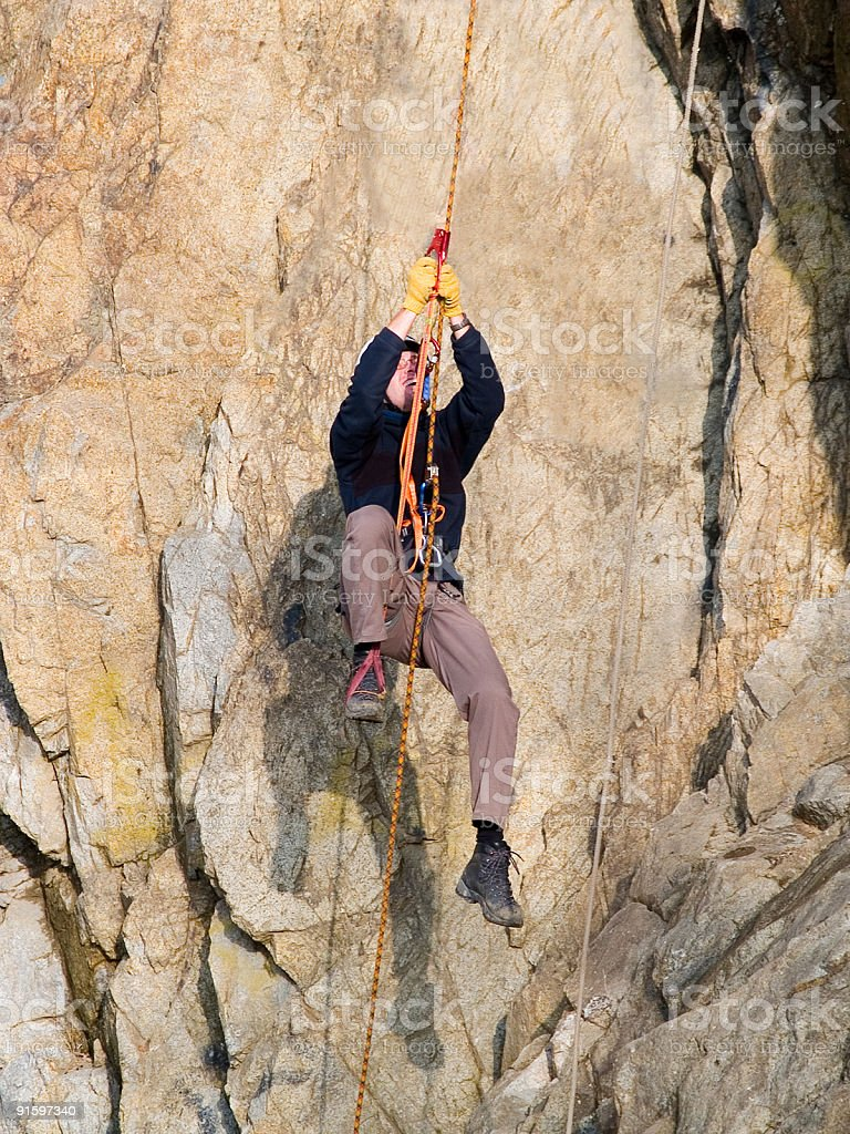 hanging climber on the rope royalty-free stock photo