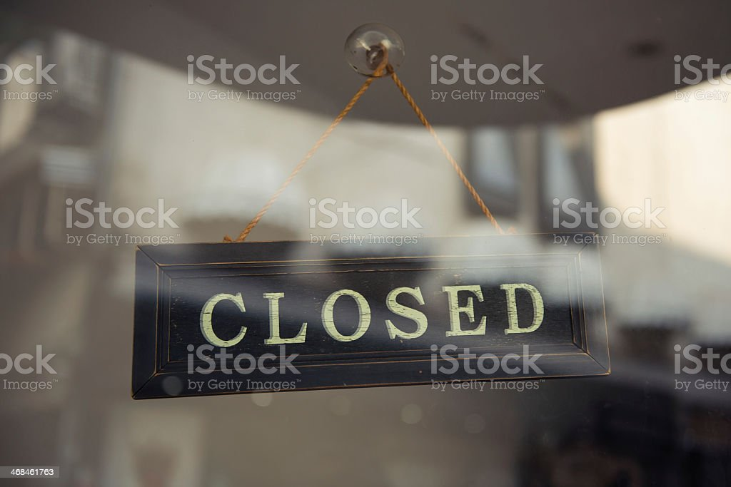 Hanging Closed sign behind glass stock photo