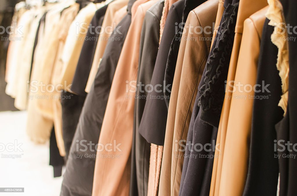 Hanging clothes in a fashion store. stock photo