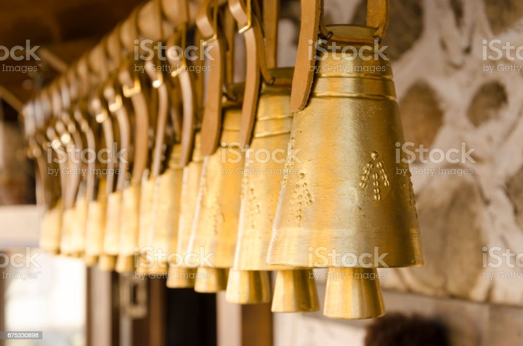Hanging cow/sheep bell with a leather strap stock photo