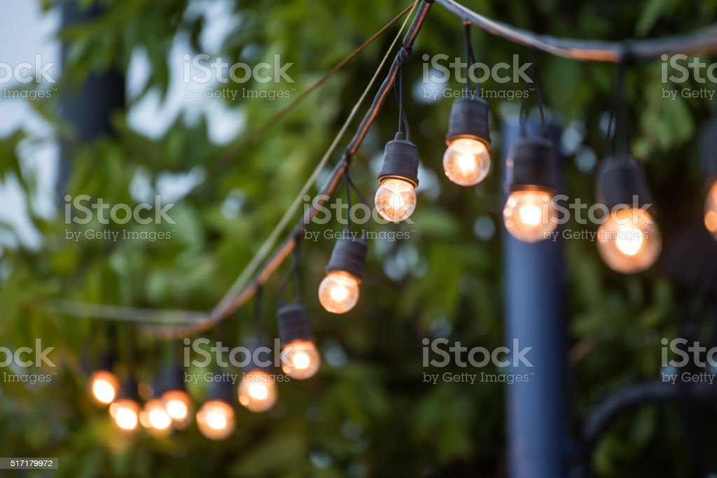 Hanging decorative christmas lights for a wedding ceremony stock photo