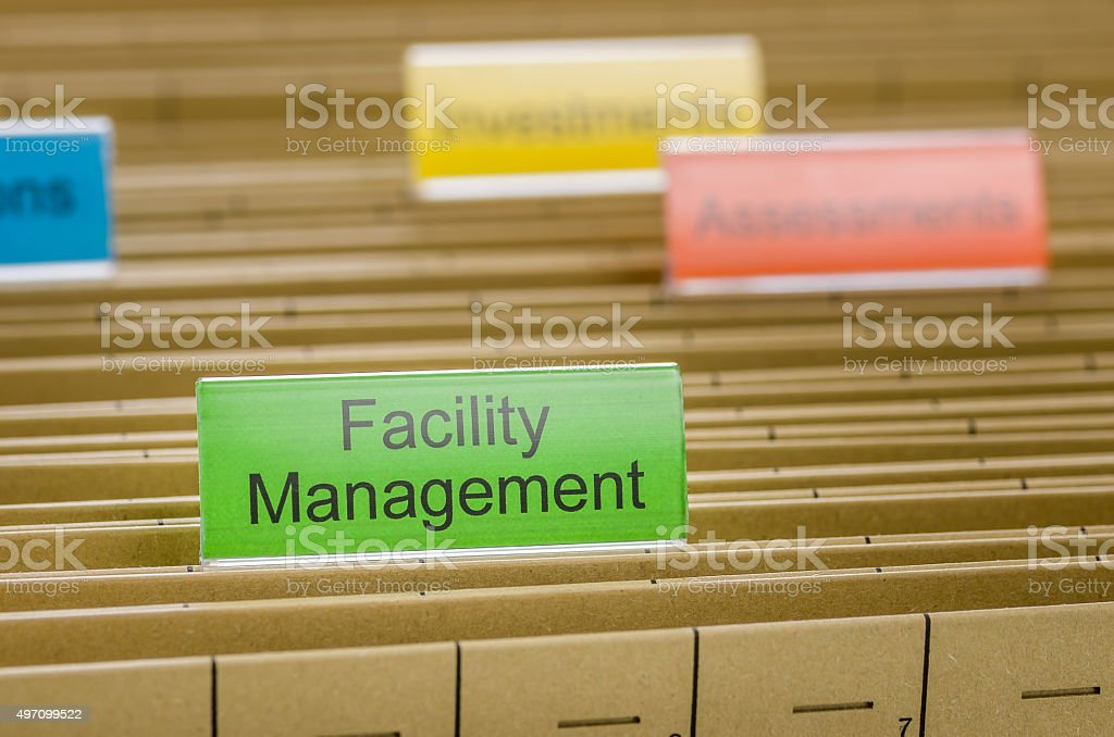 Hanging file folder labeled with Facility Management stock photo