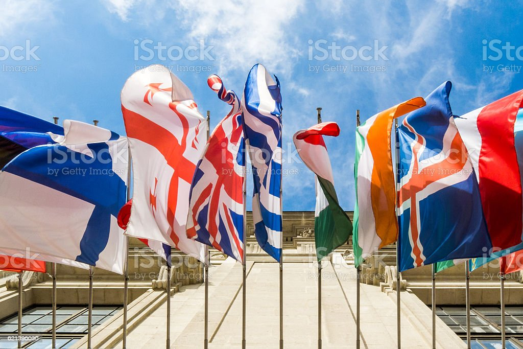 Hanging flags on building stock photo
