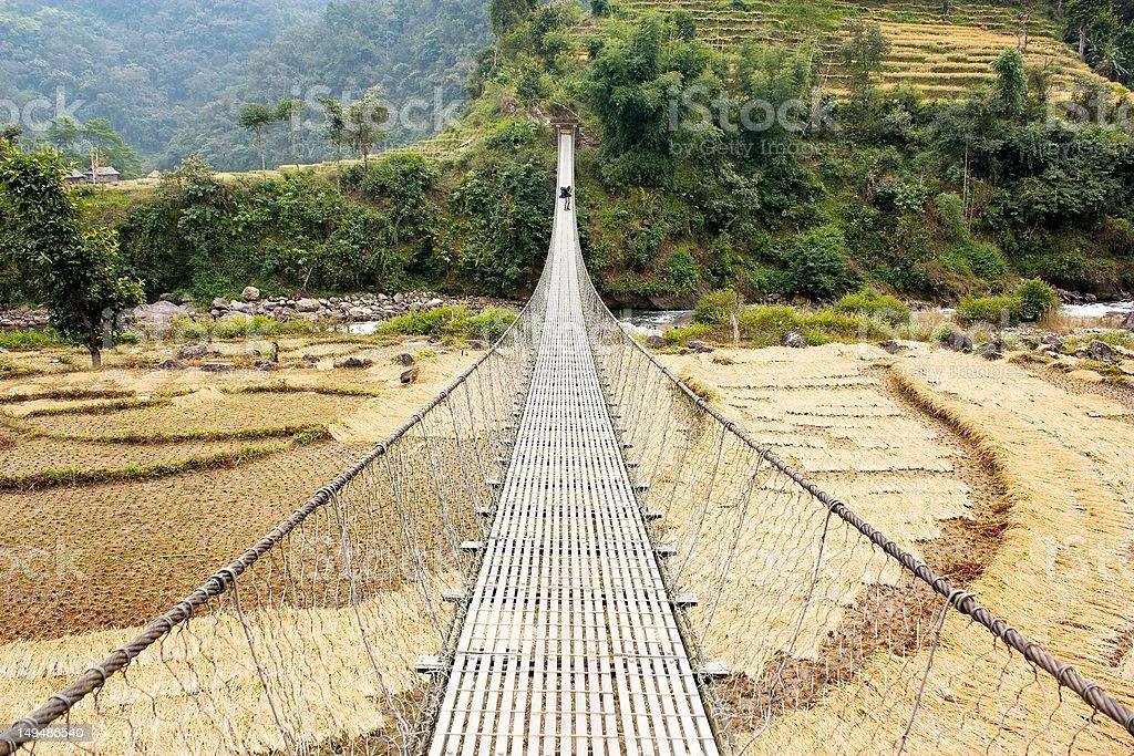 hanging footbridge in Nepal stock photo