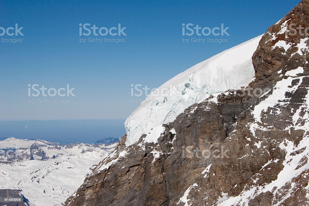 Hanging glacier on the south flank of Mönch in Switzerland royalty-free stock photo