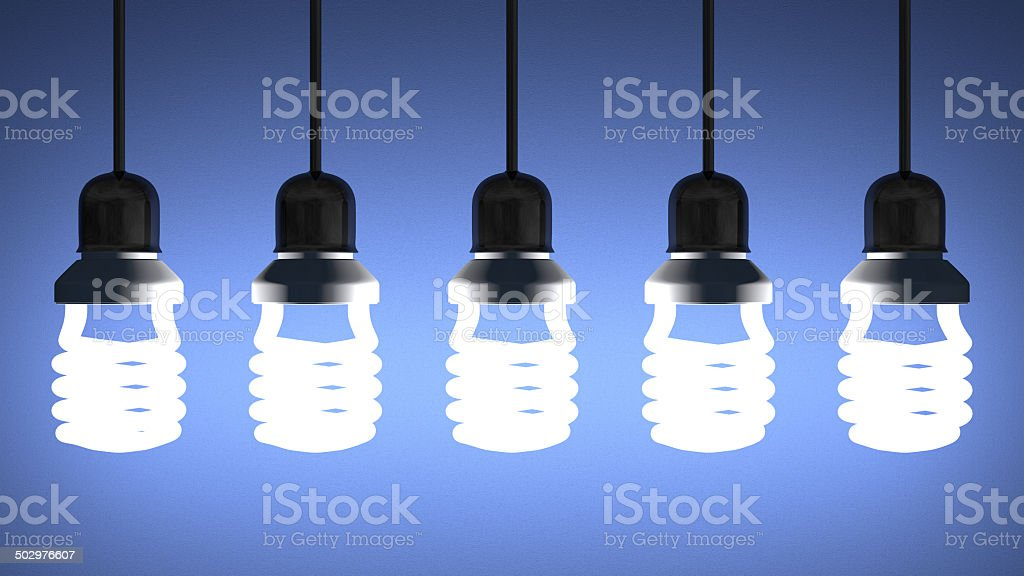 Hanging glowing spiral light bulbs on blue stock photo