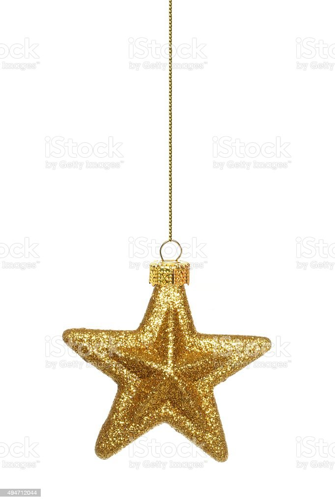 Hanging gold star Christmas ornament over white stock photo