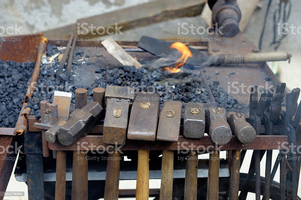 hanging hammers at the forge cart stock photo