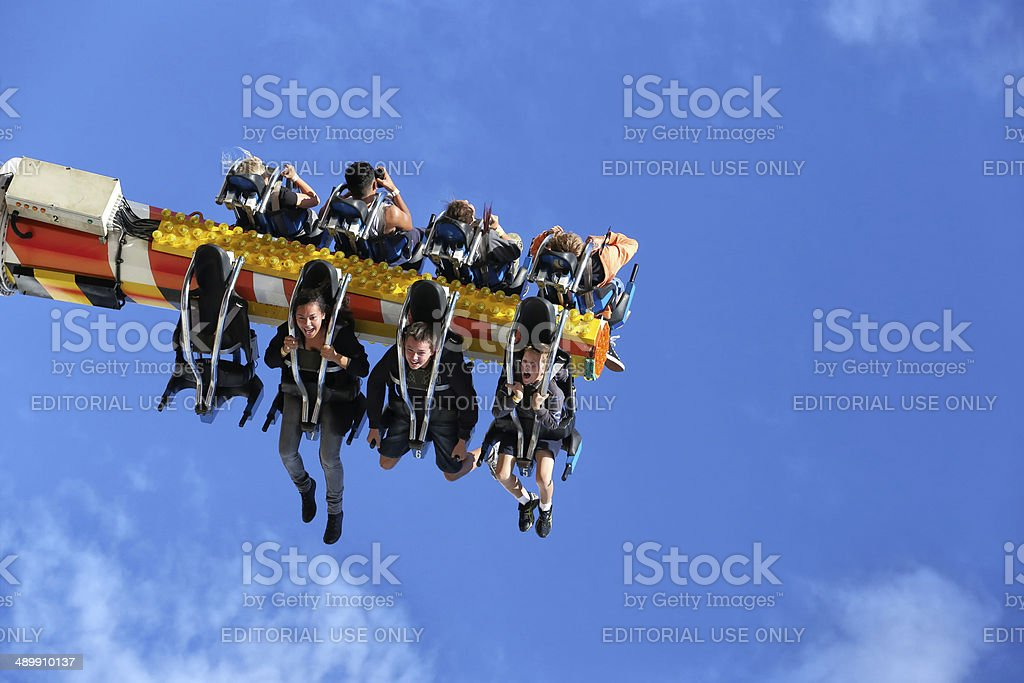 Hanging in the air on a funfair ride stock photo