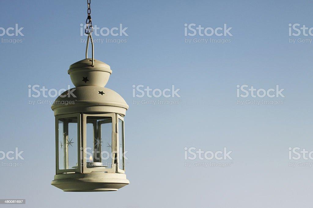 Hanging lamp on blue sky stock photo