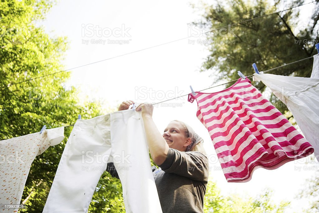 Hanging Laundry Woman in the Back Yard stock photo
