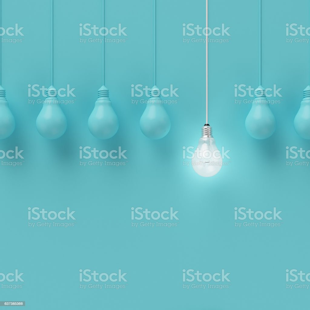 Hanging light bulbs with glowing one different idea. stock photo