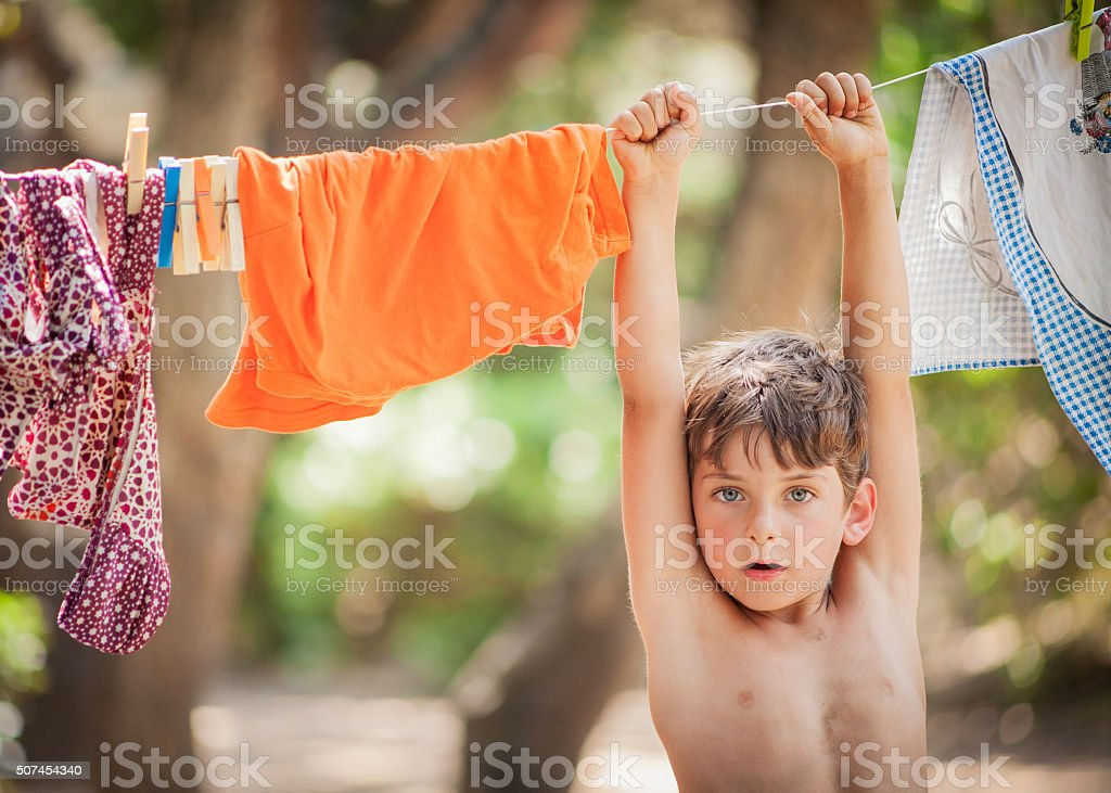 Hanging Little Boy stock photo