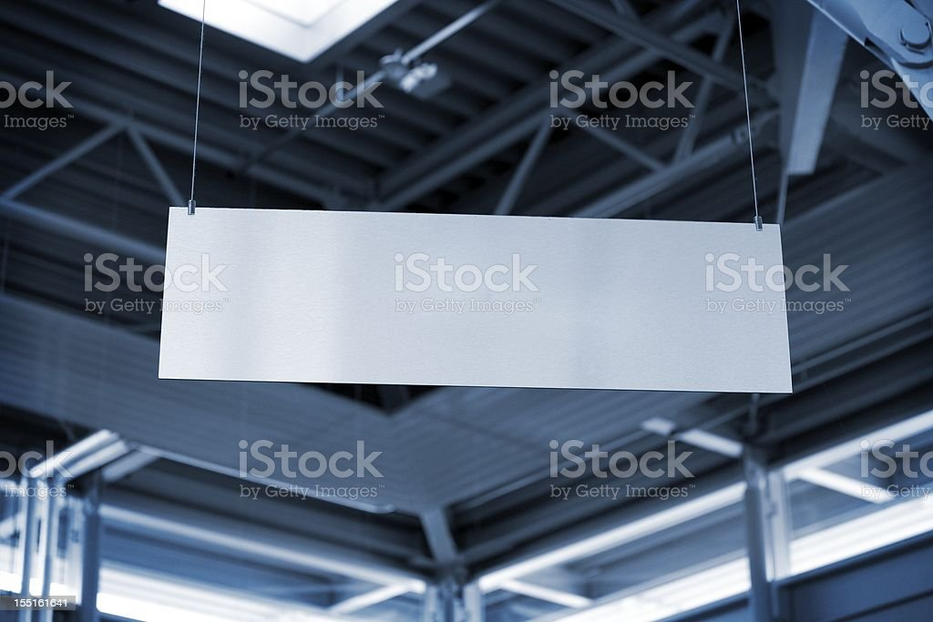 hanging metal billboard in business room stock photo