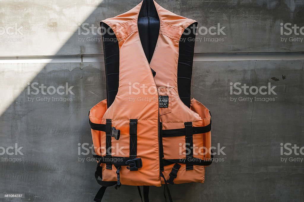 Hanging old life saving vest stock photo