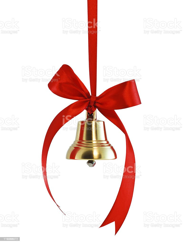 Hanging on a ribbon golden bell with red bow stock photo