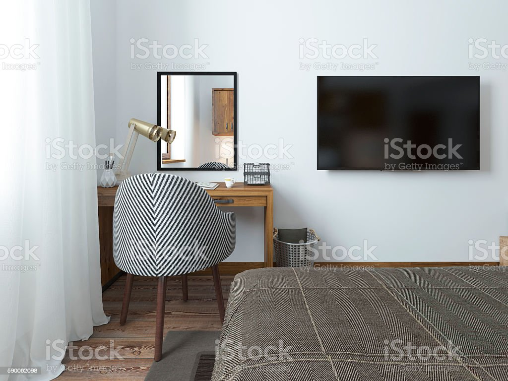 TV hanging on the wall and desk in the bedroom stock photo
