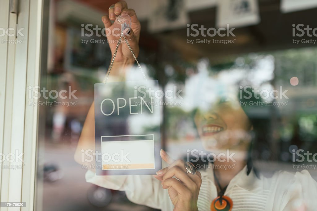 Hanging open sign stock photo