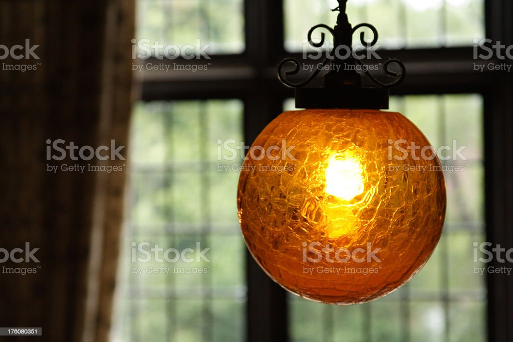 Hanging Orange Spherical Light Fixture in Victorian Mansion royalty-free stock photo