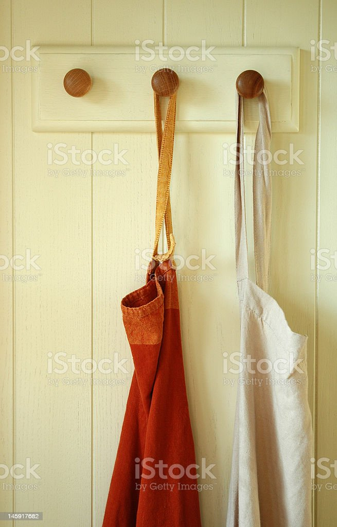 Hanging pair of Aprons stock photo