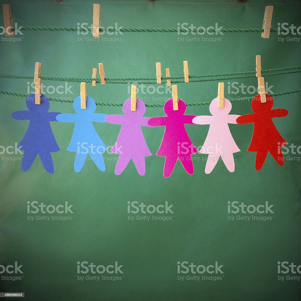 Hanging paper girls royalty-free stock photo