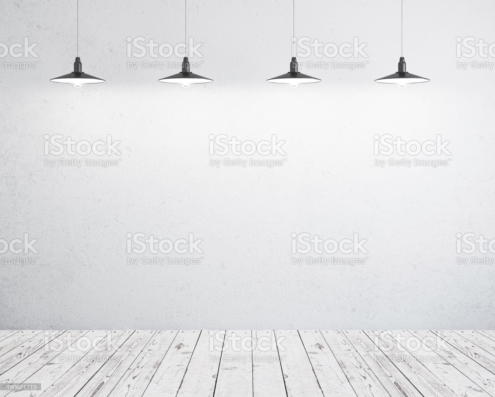 Hanging pendant lights over a room with a wooden floor royalty-free stock photo