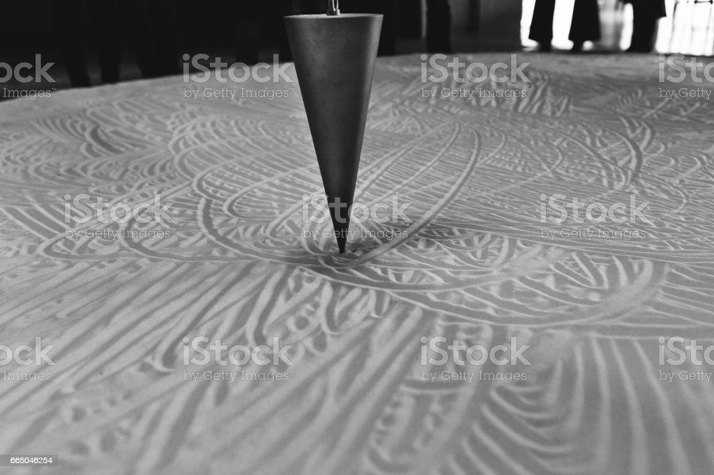 hanging pendulum in cone shape stock photo