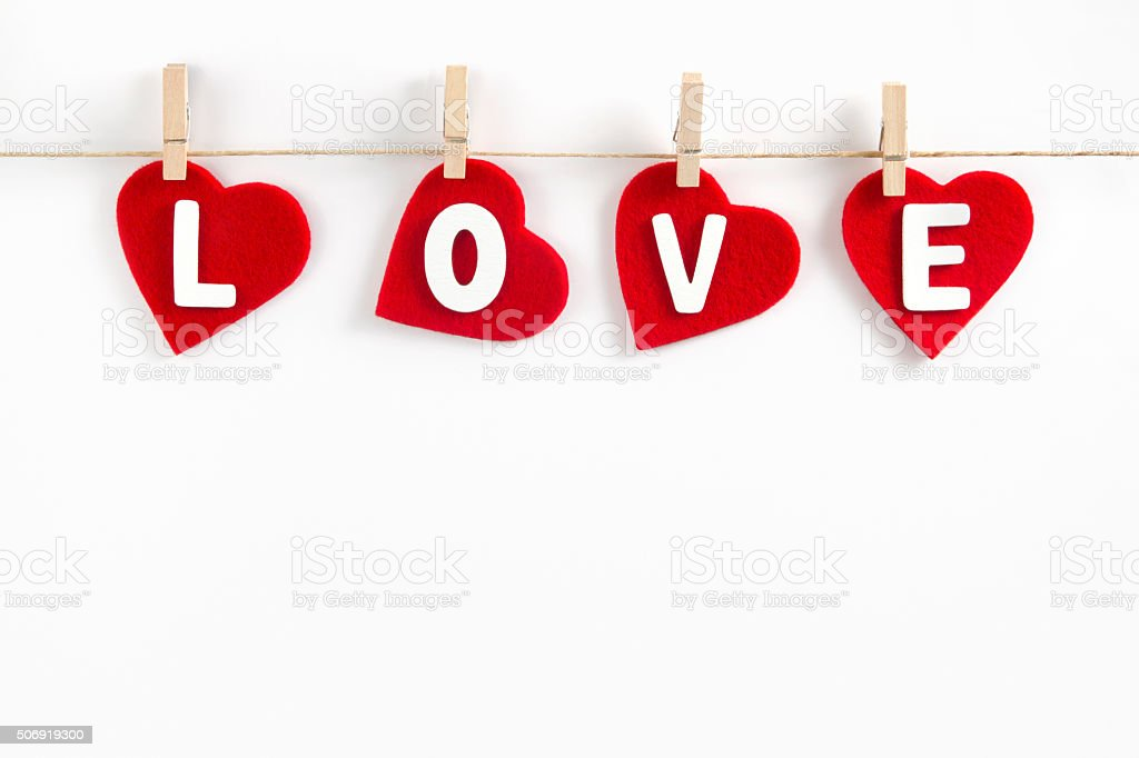Hanging Red Hearts on Clothesline stock photo