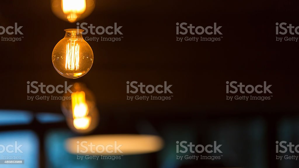 Hanging retro light bulbs stock photo