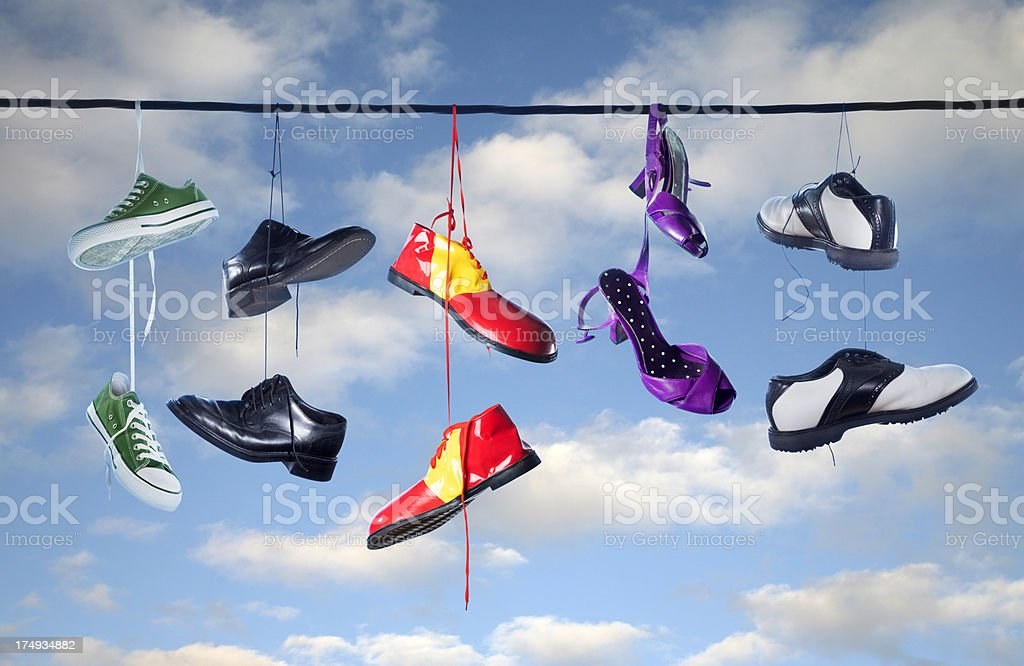 Hanging Shoes on a Telephone Wire royalty-free stock photo