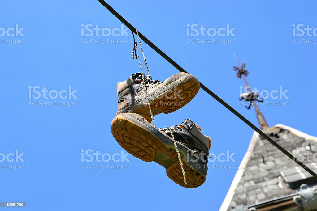 hanging shoes stock photo