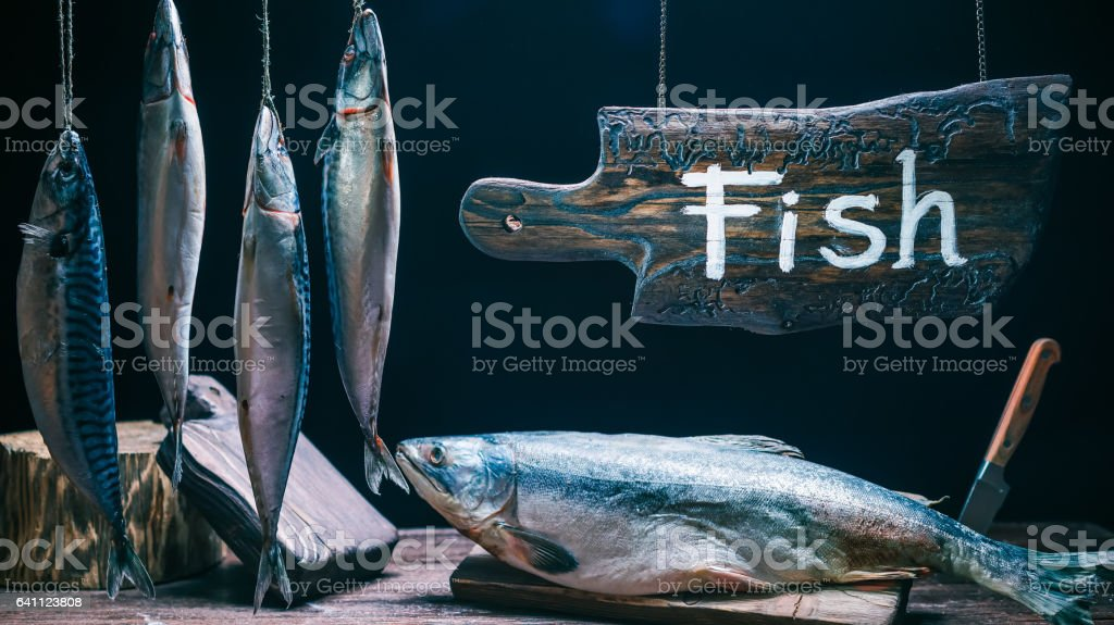 Hanging sign in seafood market stock photo