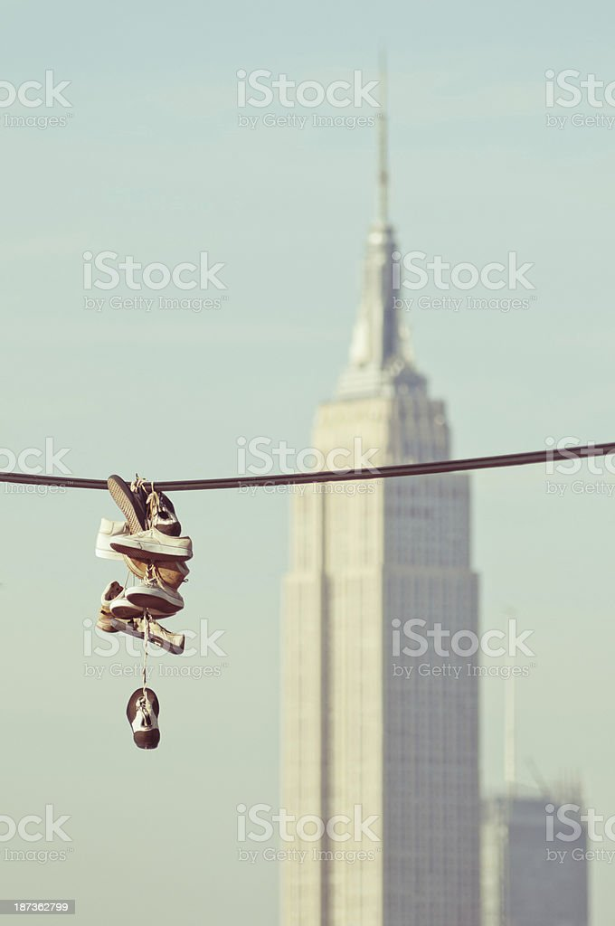 Hanging sneakers NYC royalty-free stock photo