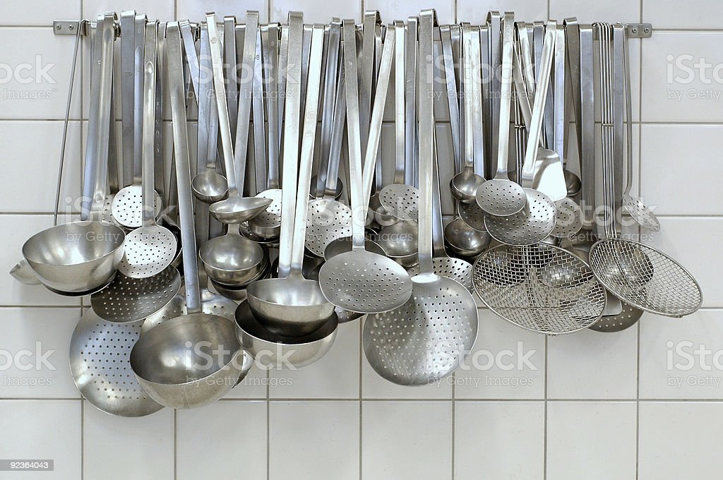 Hanging spoons and sieves royalty-free stock photo