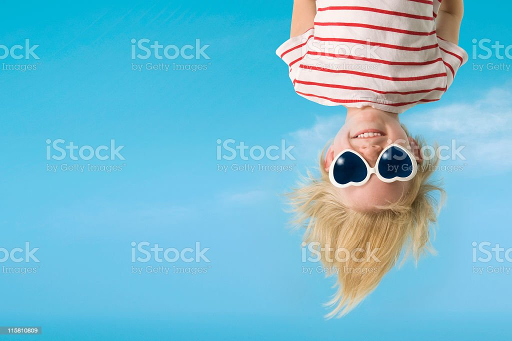 Hanging upside down is fun stock photo