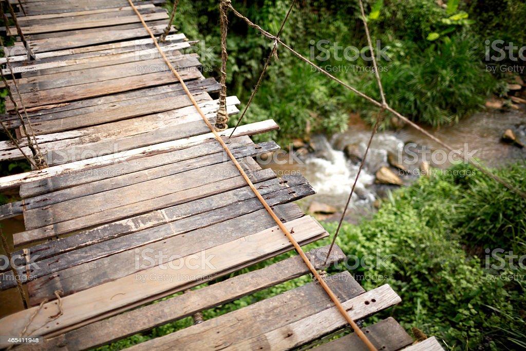Hanging wooden bridge royalty-free stock photo