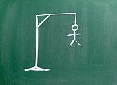 hangman sketched on blackboard