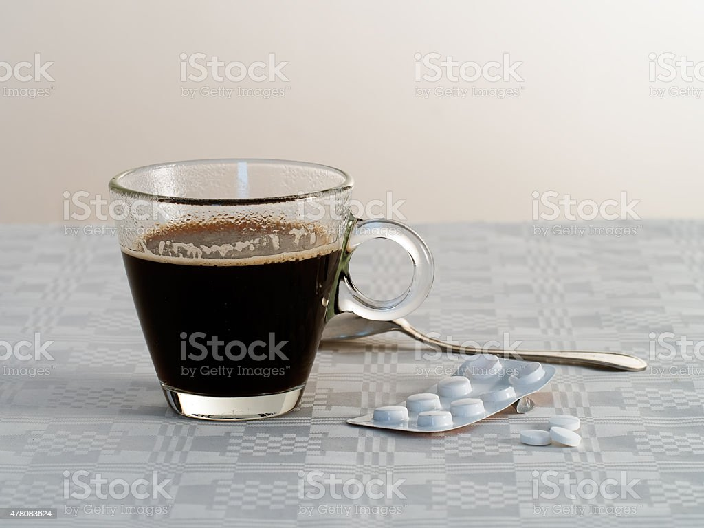 Hangover, hungover breakfast. Black coffee and aspirin painkillers stock photo