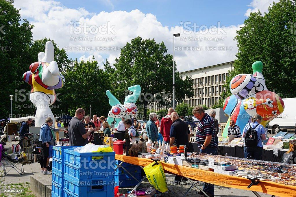 Hannover flea market and Nana sculptures by Niki de Saint stock photo