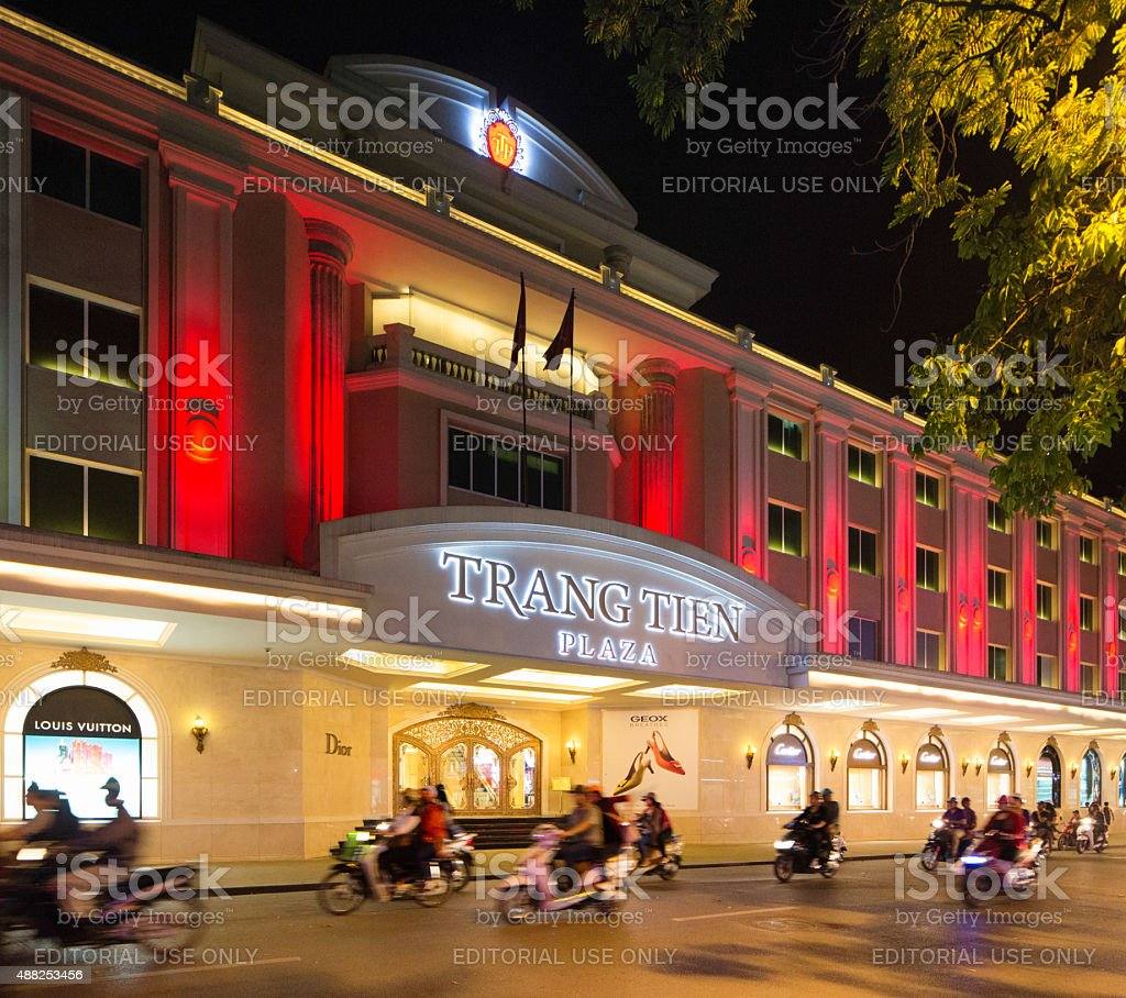 Hanoi Trang Tien Plaza entrance at night with motorbike traffic stock photo