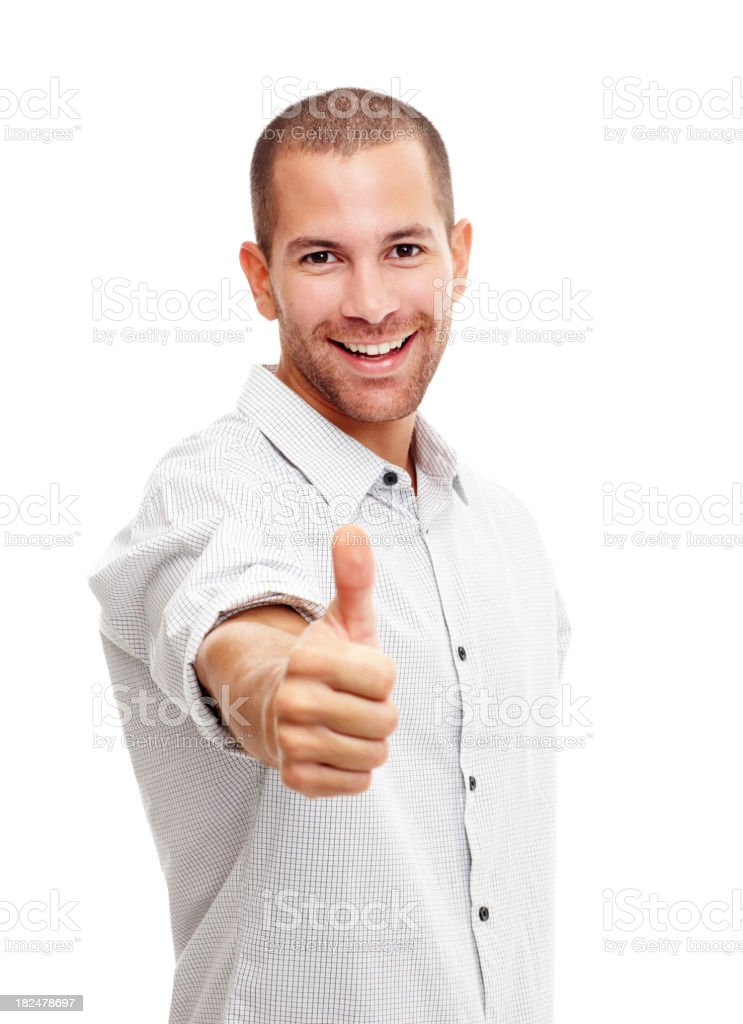 Hanppy young man giving you a thumbs up stock photo
