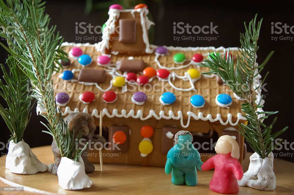 Hansel and Gretel with gingerbread house stock photo