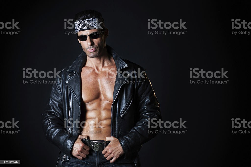 Hansome muscular man in biker leather jacket portrait royalty-free stock photo