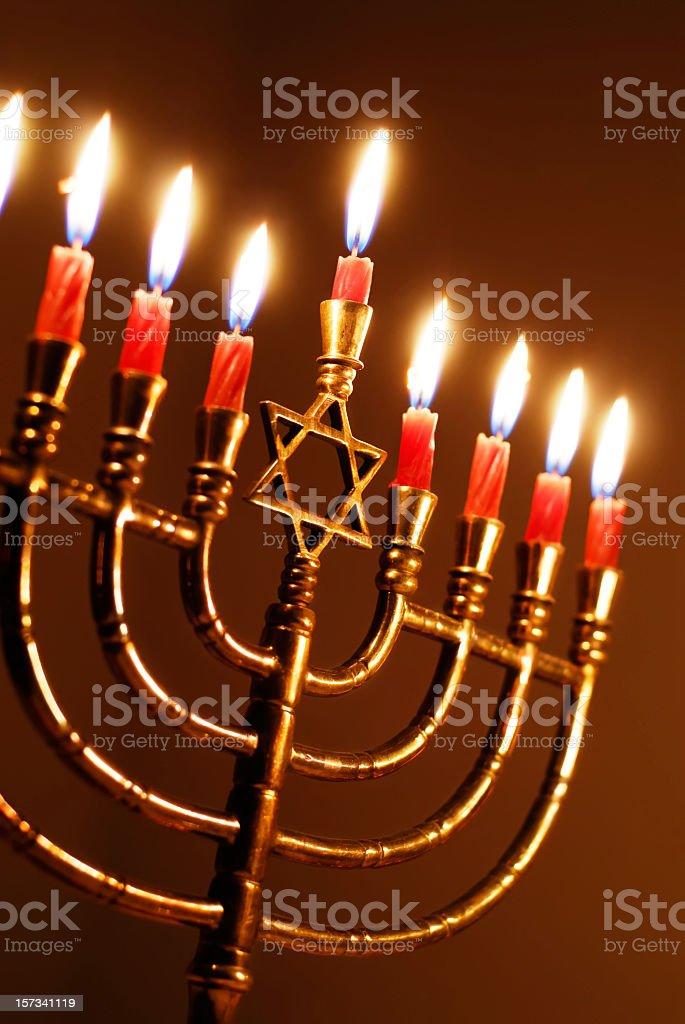 Hanukkah Menorah candles in red color royalty-free stock photo