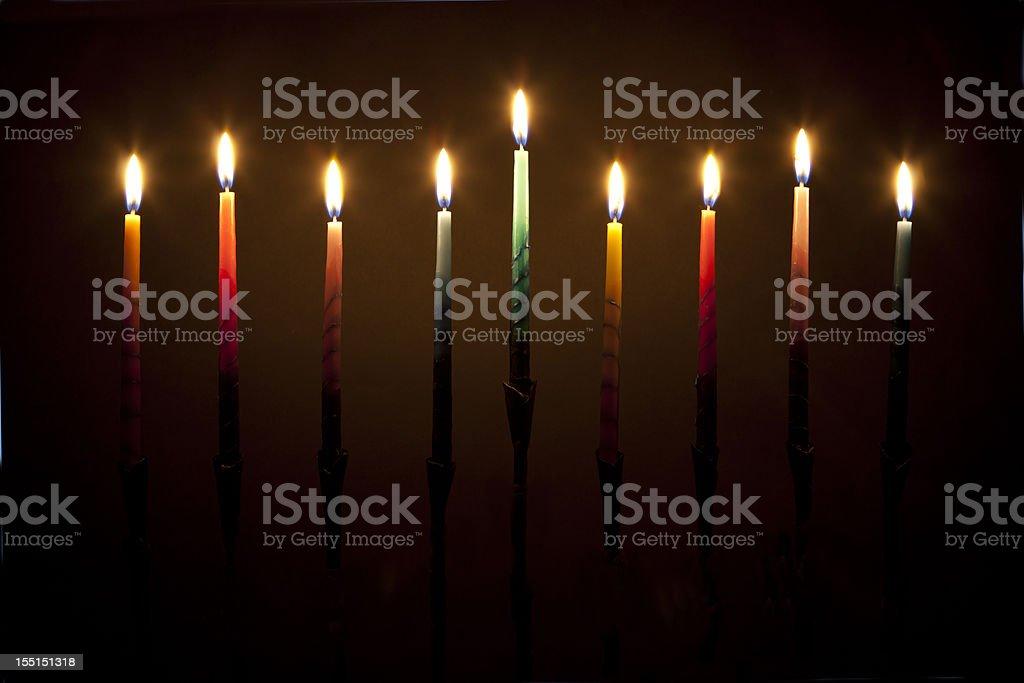 Hanukkah menorah candles lit on black background  stock photo